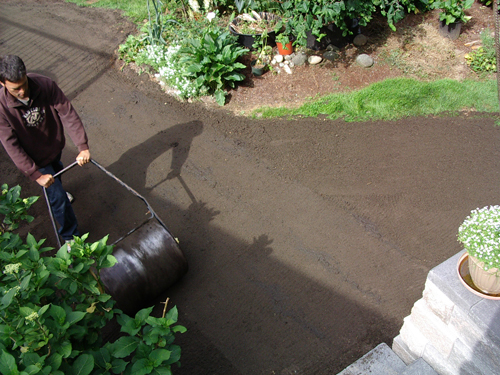 Rolling soil for a new lawn